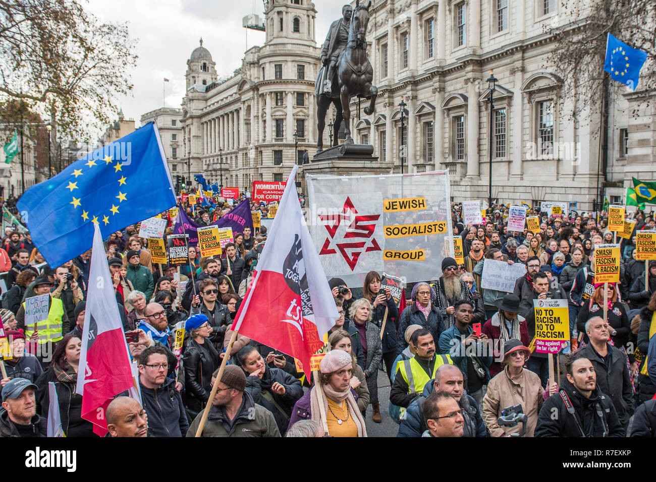 A counter protest organised by Stand Up to Racism, the Labour Party, unions and anti facist groups arrives in Whitelhall from Portland Place.As Tommy Robinson leads a UKIP Brexit Betrayal - Brexit Means Exit March through central London to Westminster. - Stock Image