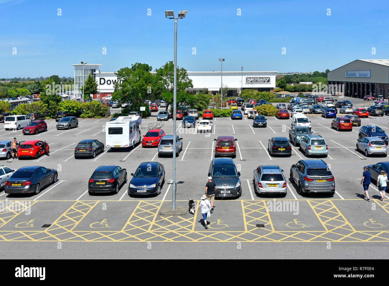 Disabled parking space in free car park at Downtown department store retail superstore warehouse shopping business Grantham Lincolnshire England UK - Stock Image