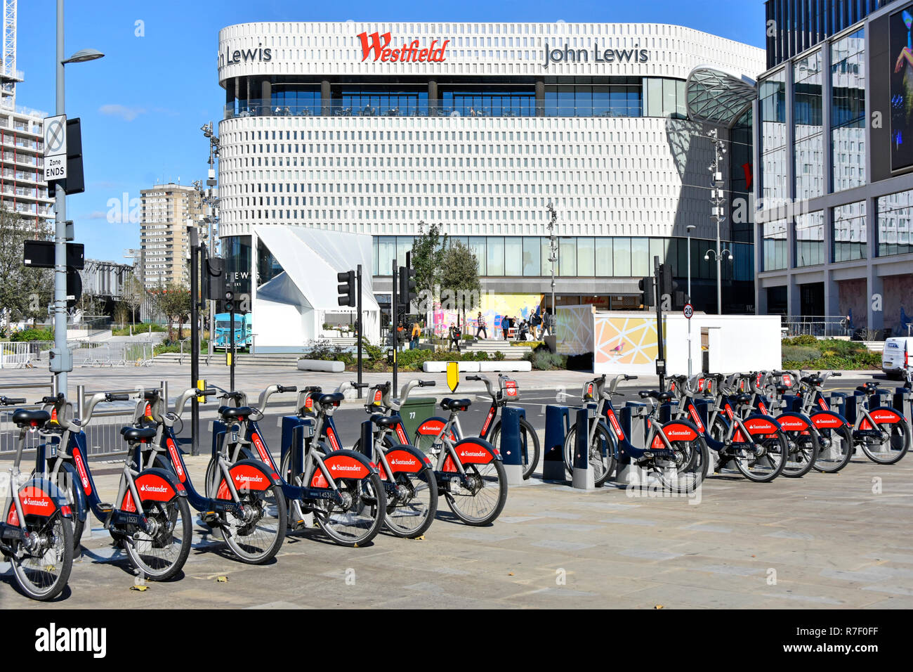 John Lewis big modern Westfield White City department store building at Shepherds Bush Westfield shopping centre Santander bike hire London England UK - Stock Image