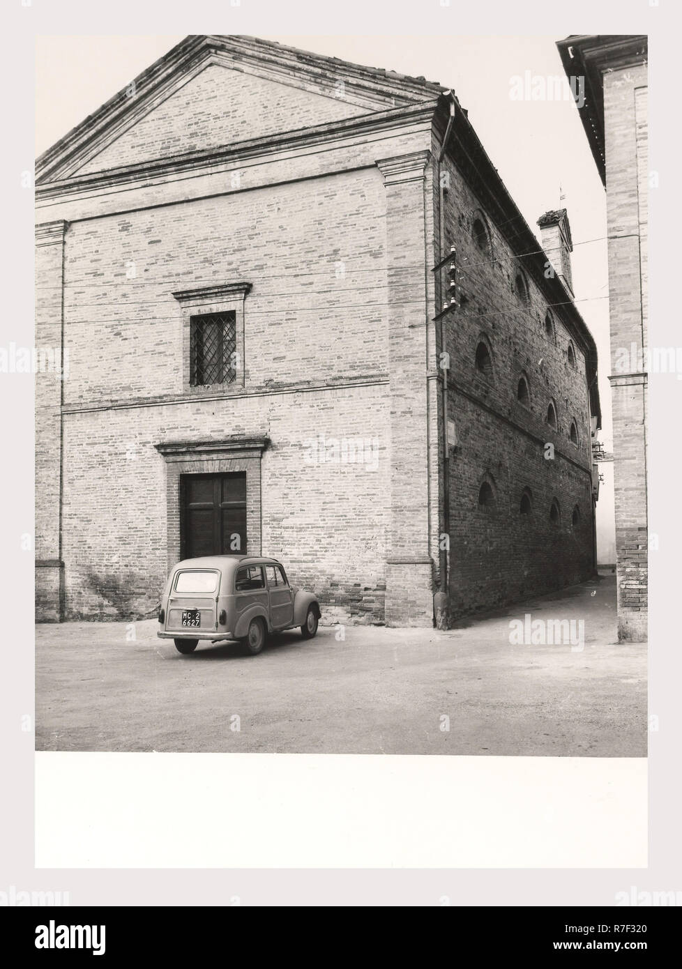 Marches Macerata Tolentino General views, this is my Italy, the italian country of visual history, Views of the Piazza della Liberta, the Torre dei Tre Orologi, the Palazzo Sangallo the palazzo Parisani, and also portals and a coat-of-arms from the historical center of Tolentino. Photo 1984 - Stock Image