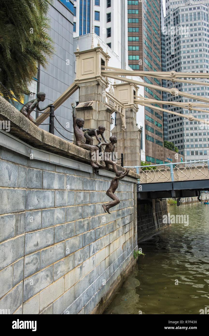 Children's sculpture near the Cavenagh bridge, Singapore - Stock Image