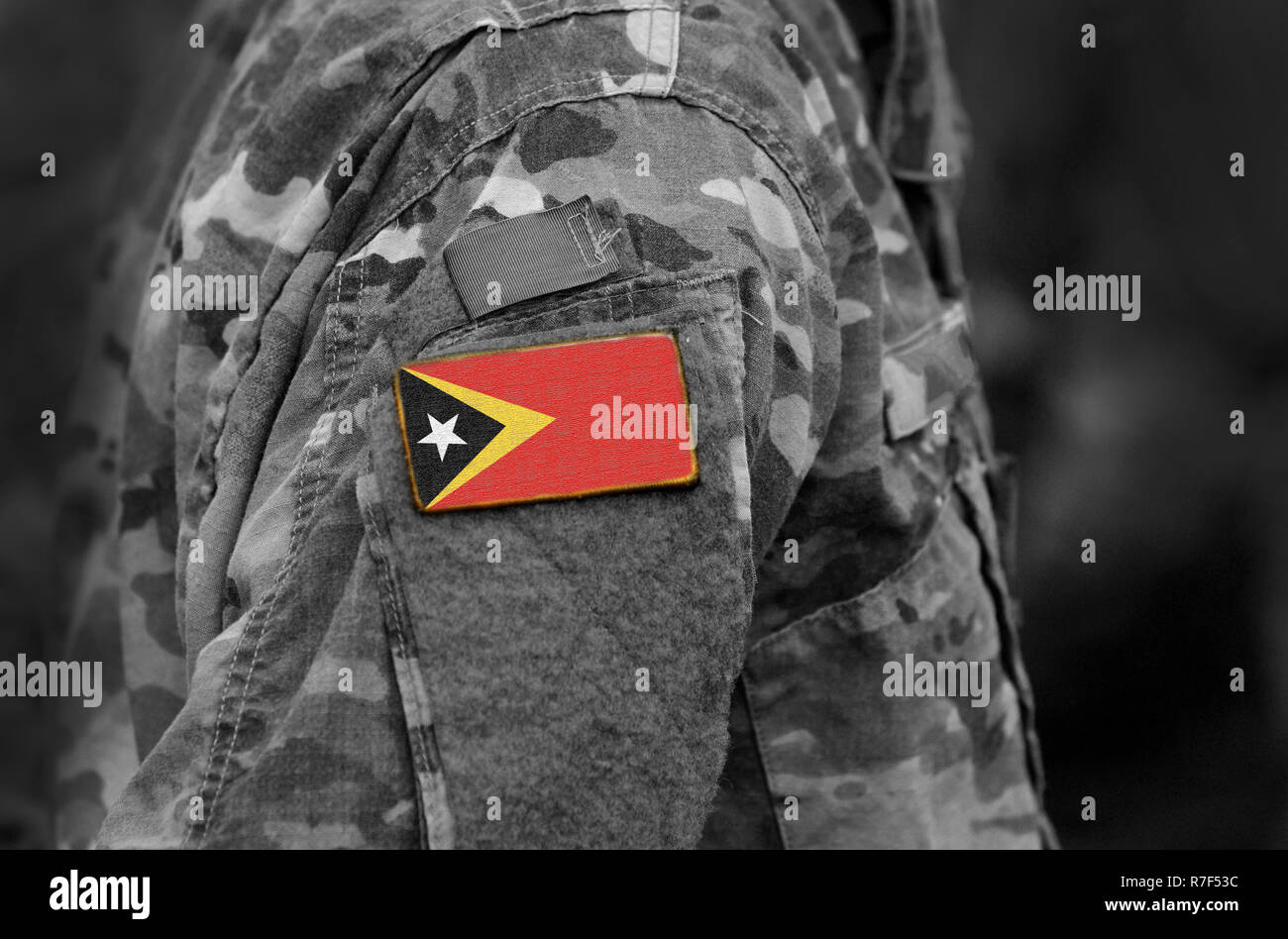 Flag of East Timor on soldiers arm. Flag of East Timor on military uniforms (collage). - Stock Image