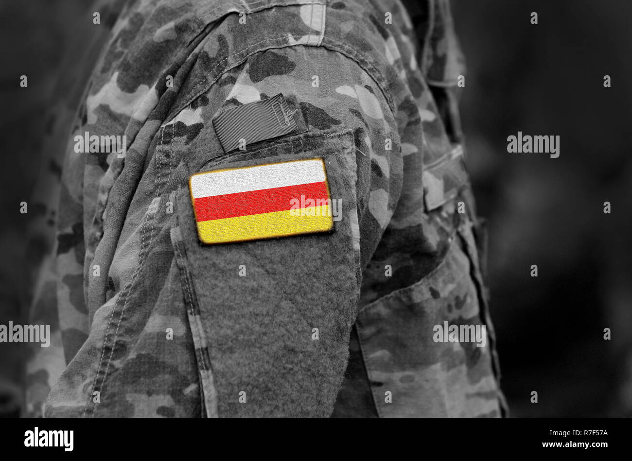 Flag of South Ossetia on soldiers arm. Flag of South Ossetia on military uniforms (collage). - Stock Image