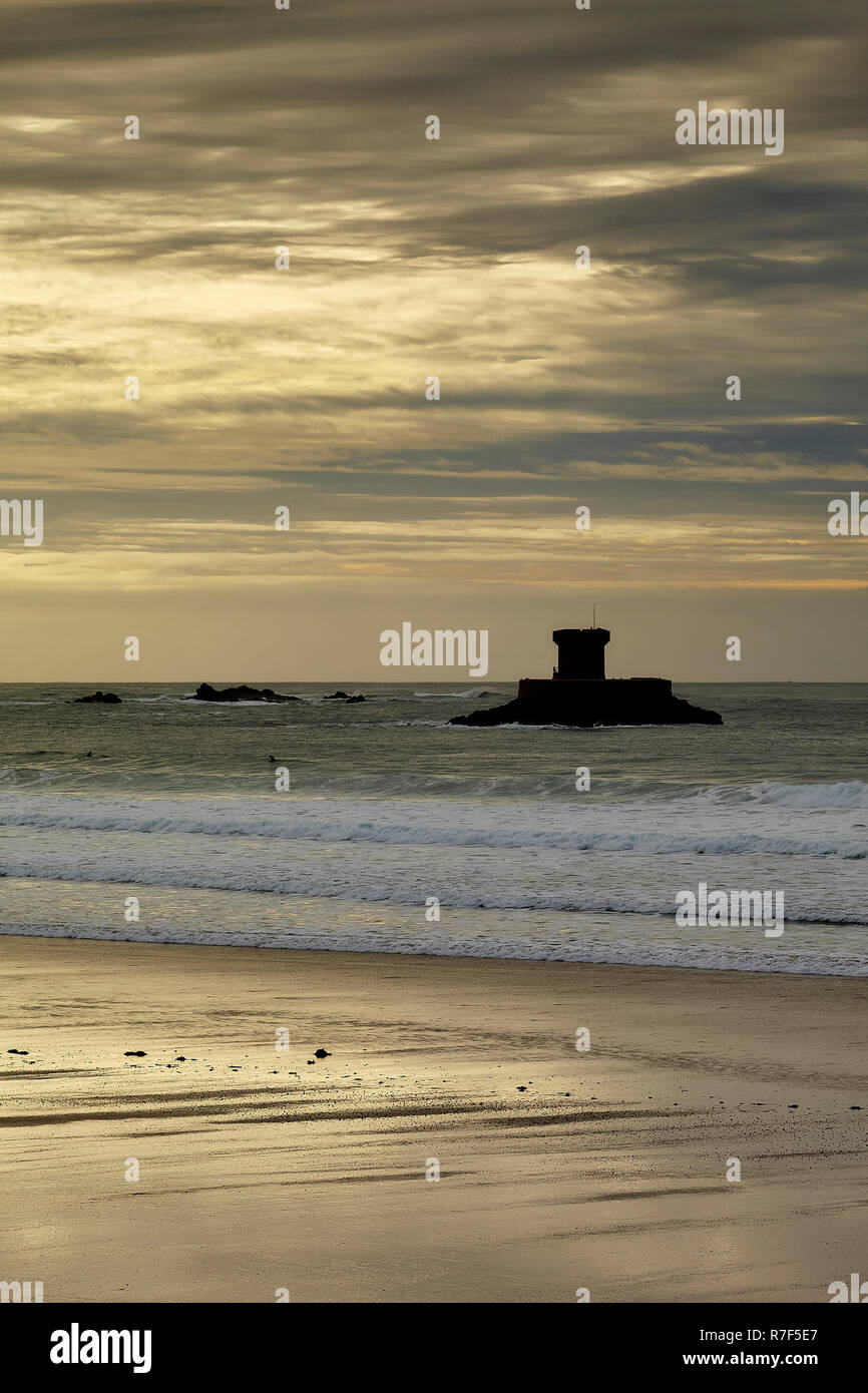 Rocco defensive tower from St Ouens Bay. - Stock Image