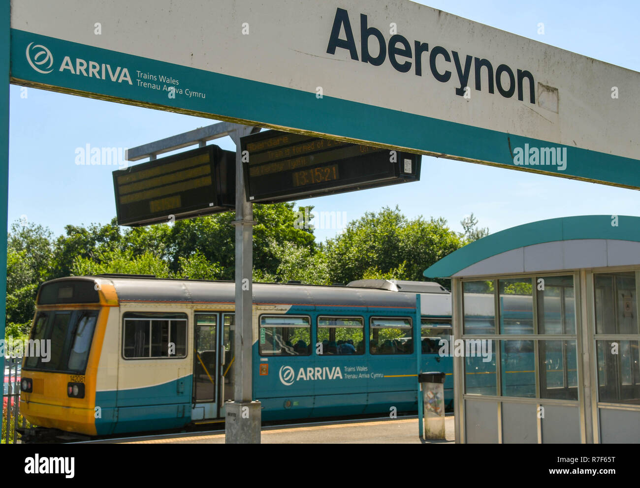 Diesel commuter train at a platform in Abercynon railway station in Rhondda Cynon Taf. The Valley Lines are part of the South Wales Metro. - Stock Image