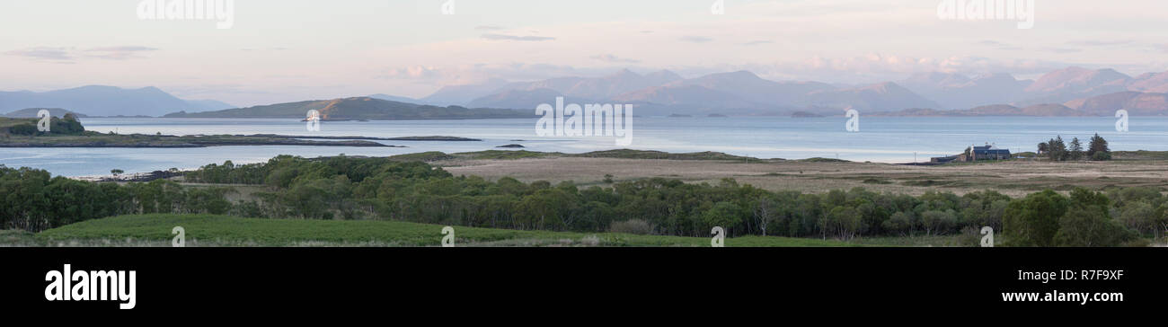 Panorama format. Views from Auchnacraig over Grasspoint and towards Oban on the mainland, Grasspoint, Mull, Isle of Mull, Argyll and Bute, Scotland Stock Photo