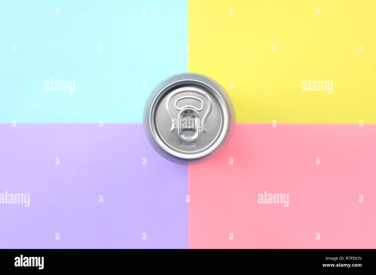 Tin aluminum silver beer can on a pastel background. Minimal flat lay top view. Living coral, violet, blue and yellow colors - Stock Image
