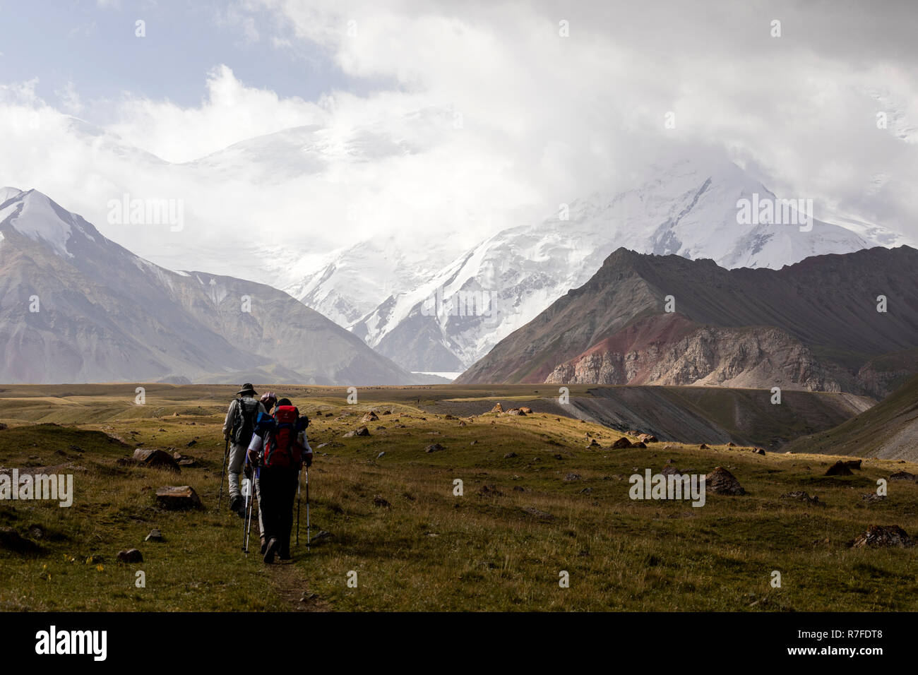 Tulpar, Kyrgyzstan August 21 2018: Tourists walk to base camp at the foot of Peak Lenin in Kyrgyzstan Stock Photo