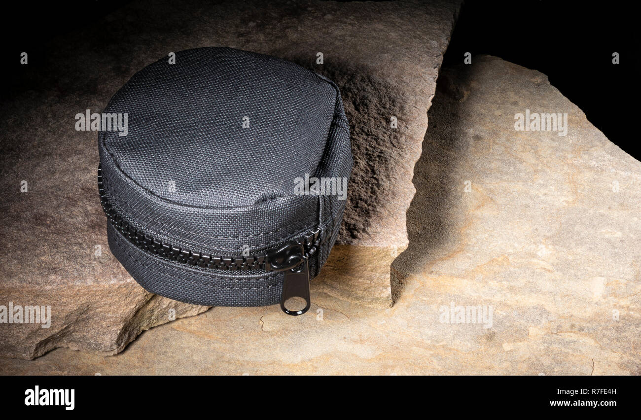 Nylon case that is for carrying tactical gear on rocks - Stock Image
