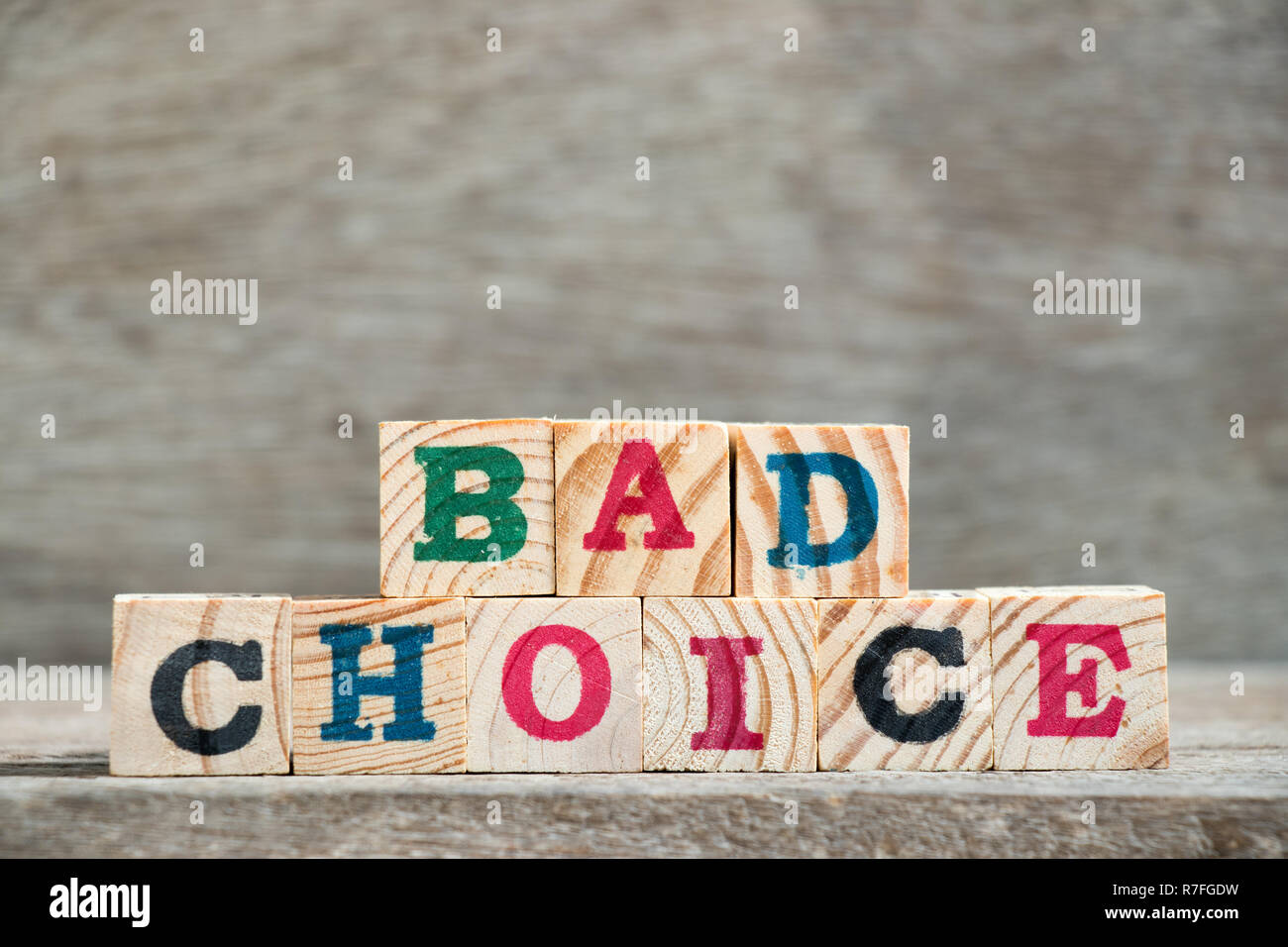 Letter block in word bad choice on wood background Stock Photo