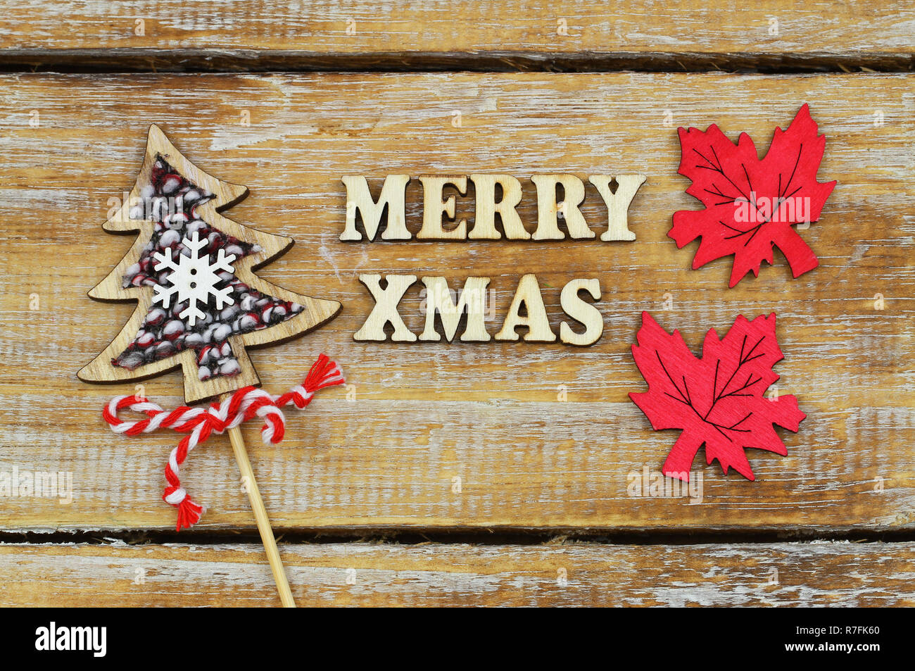 Merry Christmas Written With Wooden Letters With Wooden Christmas Tree And Painted Wooden Leaves Stock Photo Alamy