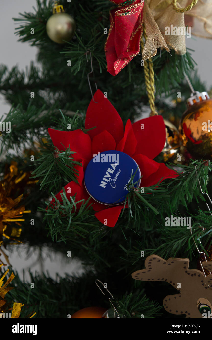 A nivea creme tin placed in a christmas tree as decoration. - Stock Image