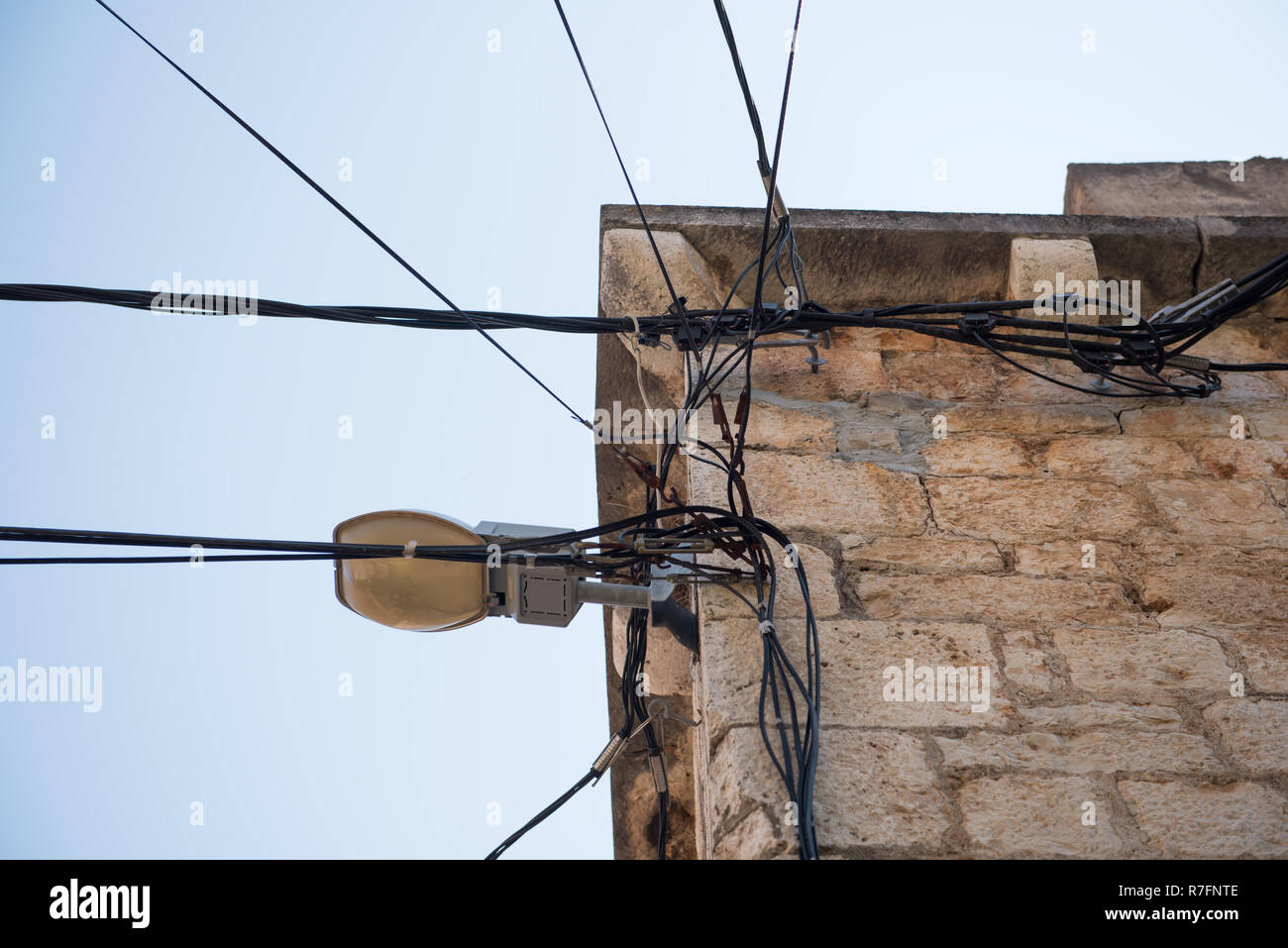 Cable Wires House Stock Photos Images Alamy How To Wire A For Electric Attached On An Old Stone Architecture Electricity Transmission Light
