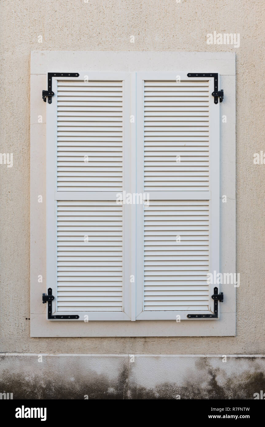 Wooden Window Closed With White Wooden Shutters Exterior