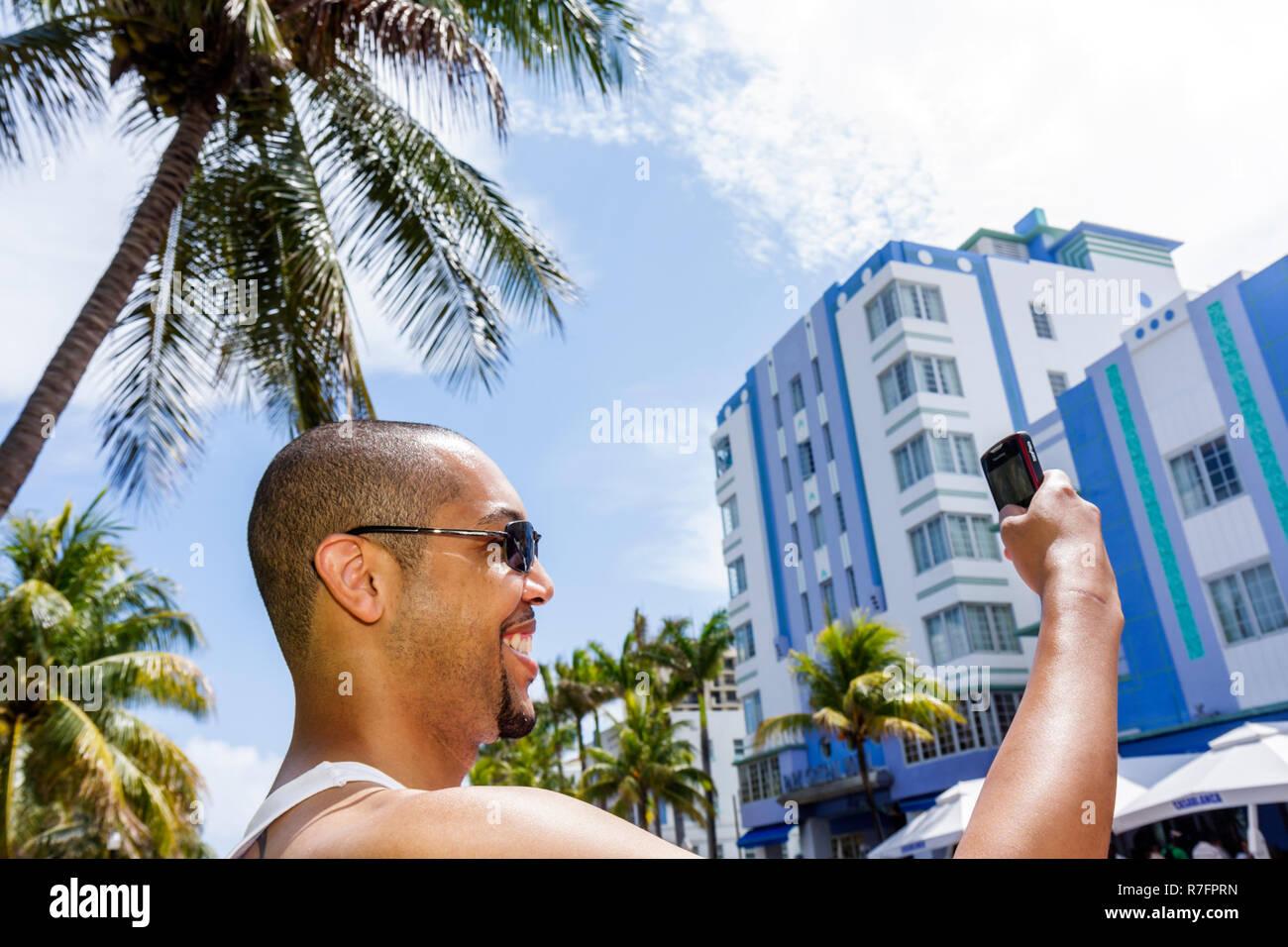 Miami Beach Florida Ocean Drive Art Deco District Urban Beach Week Spring Break Memorial Day Weekend hip hop culture Black man - Stock Image