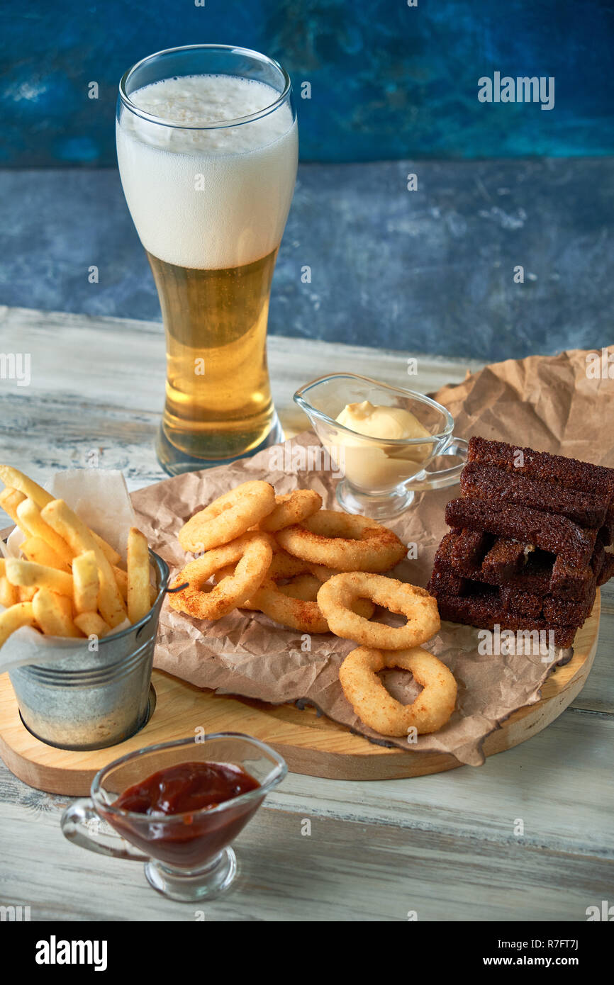 a variety of snacks for light beer in a glass Stock Photo
