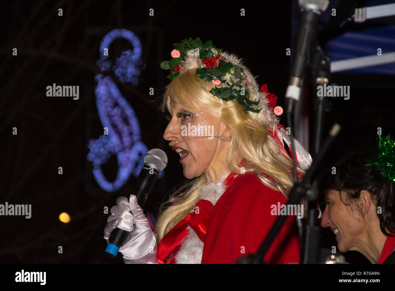 Melody Burke performing at East Dulwich Christmas cracker 1st December 2018 with a presenter looking on - Stock Image