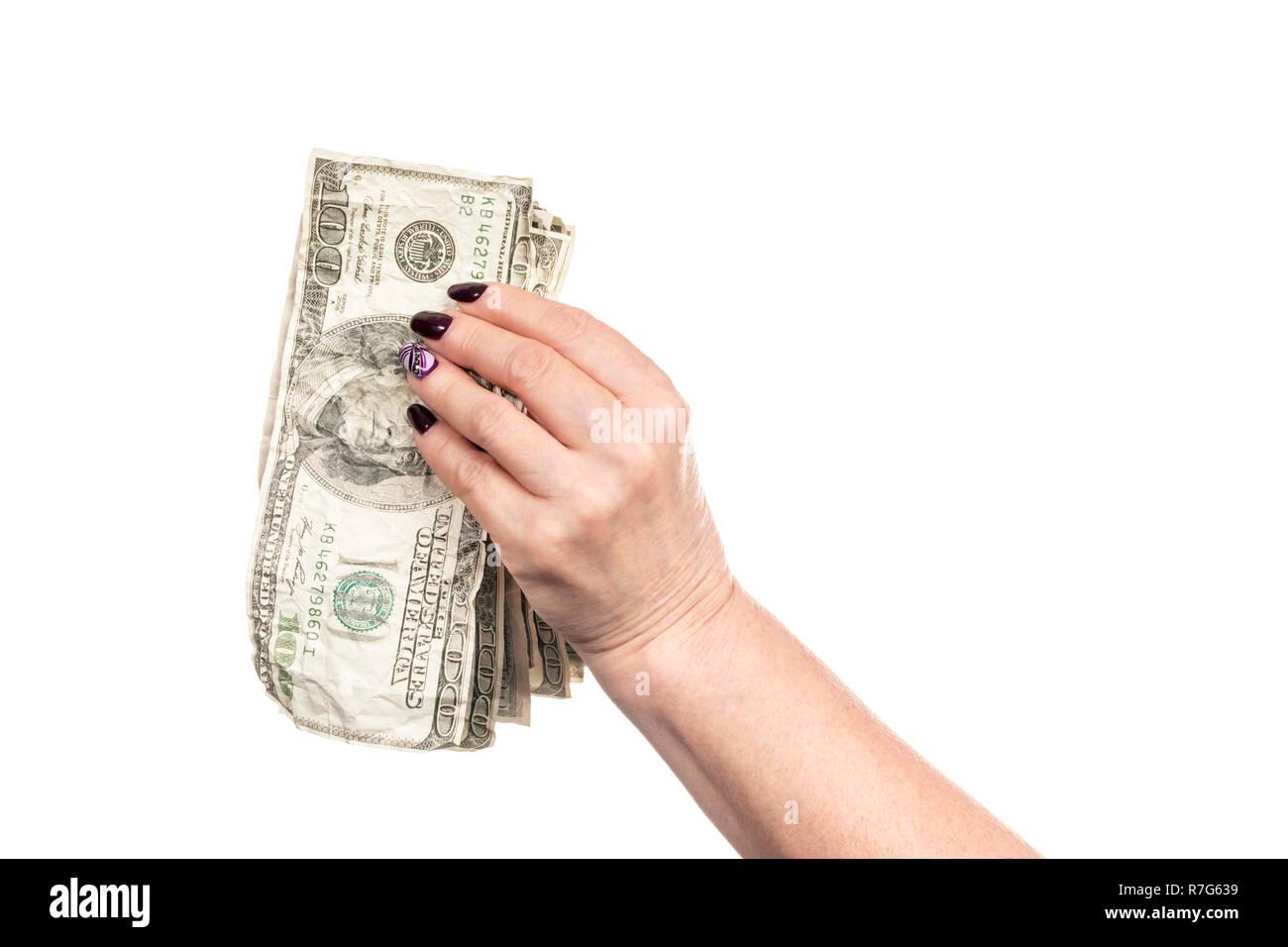 crumpled money in female hand - Stock Image
