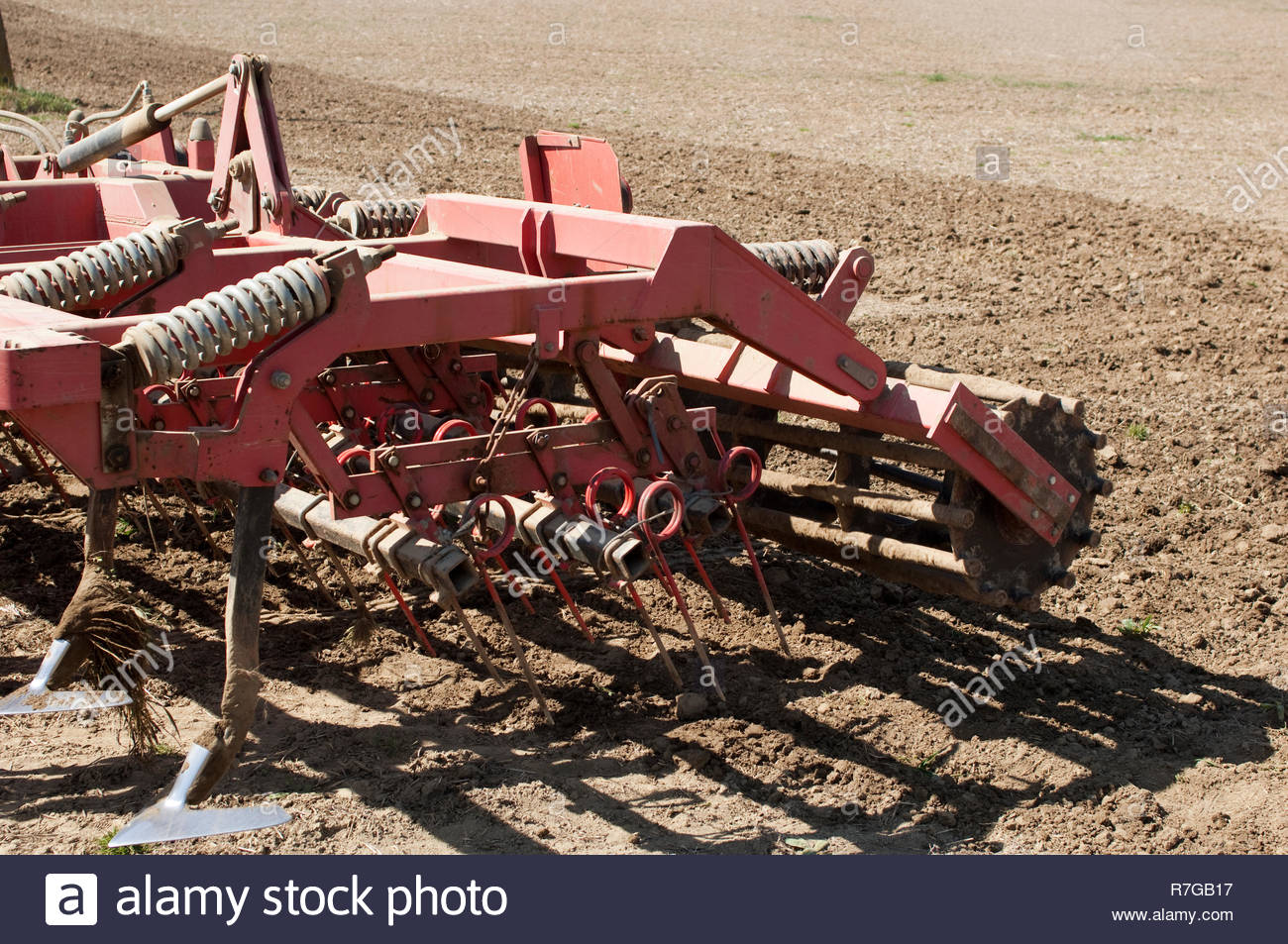 Cultivator prepares spring field for seeding. Stock Photo