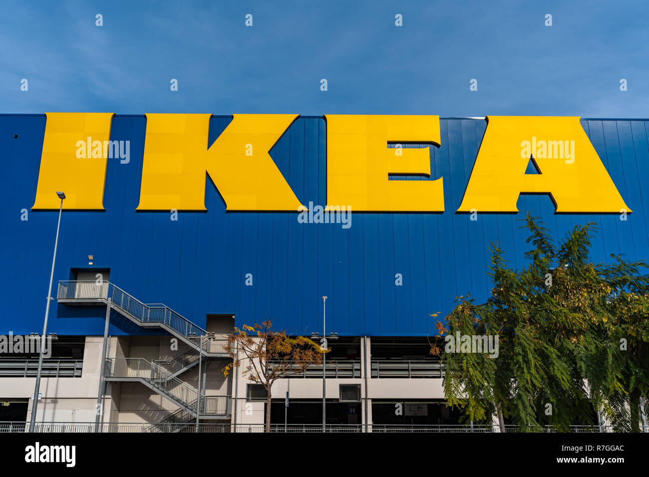 Valencia,Spain - December 09, 2018: Ikea store lot in Alfafar, Valencia. Huge  yellow Ikea word on blue background. Blue skyes on the top. Exterior vi - Stock Image
