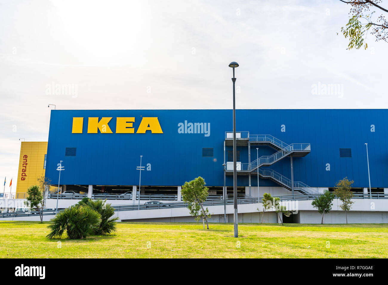 Valencia,Spain - December 09, 2018: Ikea store lot in Alfafar, Valencia. Big yellow Ikea word on blue background. Skyes on the top. Exterior view. - Stock Image