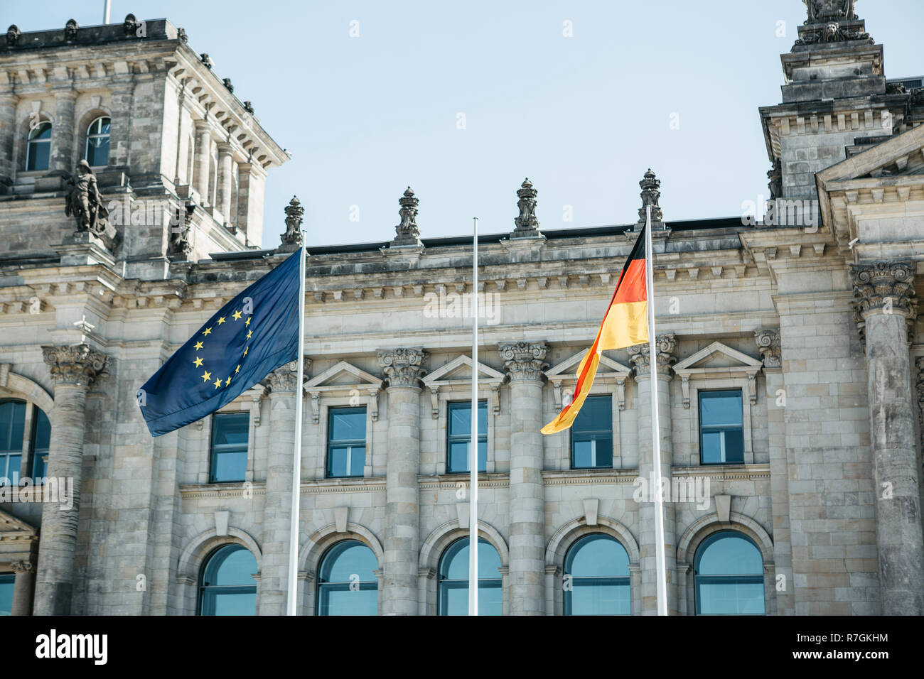 German flag and the EU flag on the Reichstag building in Berlin in Germany - Stock Image