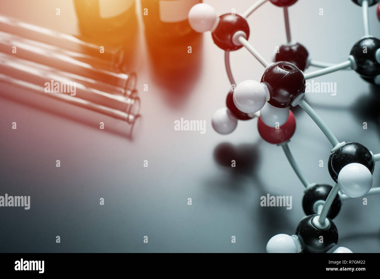 molecular formula and laboratory equipment on blue background. Science organic chemistry concept Stock Photo
