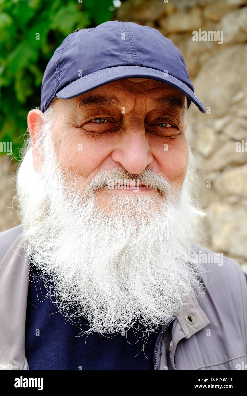 Portrait of bearded man wearing a cap - Stock Image
