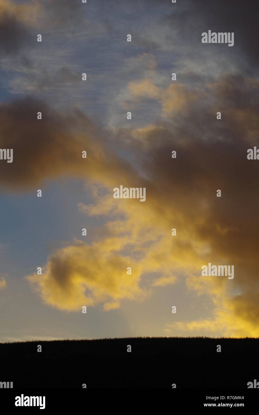 Golden Sunset Illuminating a Cloud. Aberdeen, Scotland, UK. - Stock Image