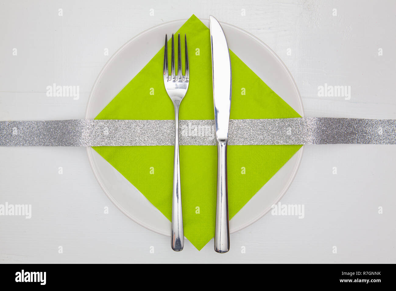 White square plate and green Christmas decoration on the ...