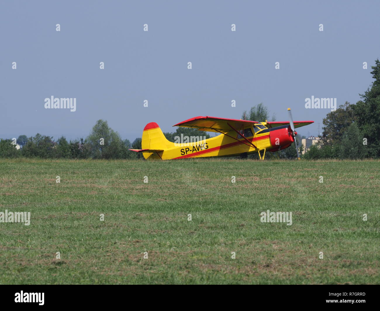 Side of beauty Yakovlev Yak-12M SP-AWG airplane lands on green grassy airfield in european Bielsko-Biala city in Poland - Stock Image