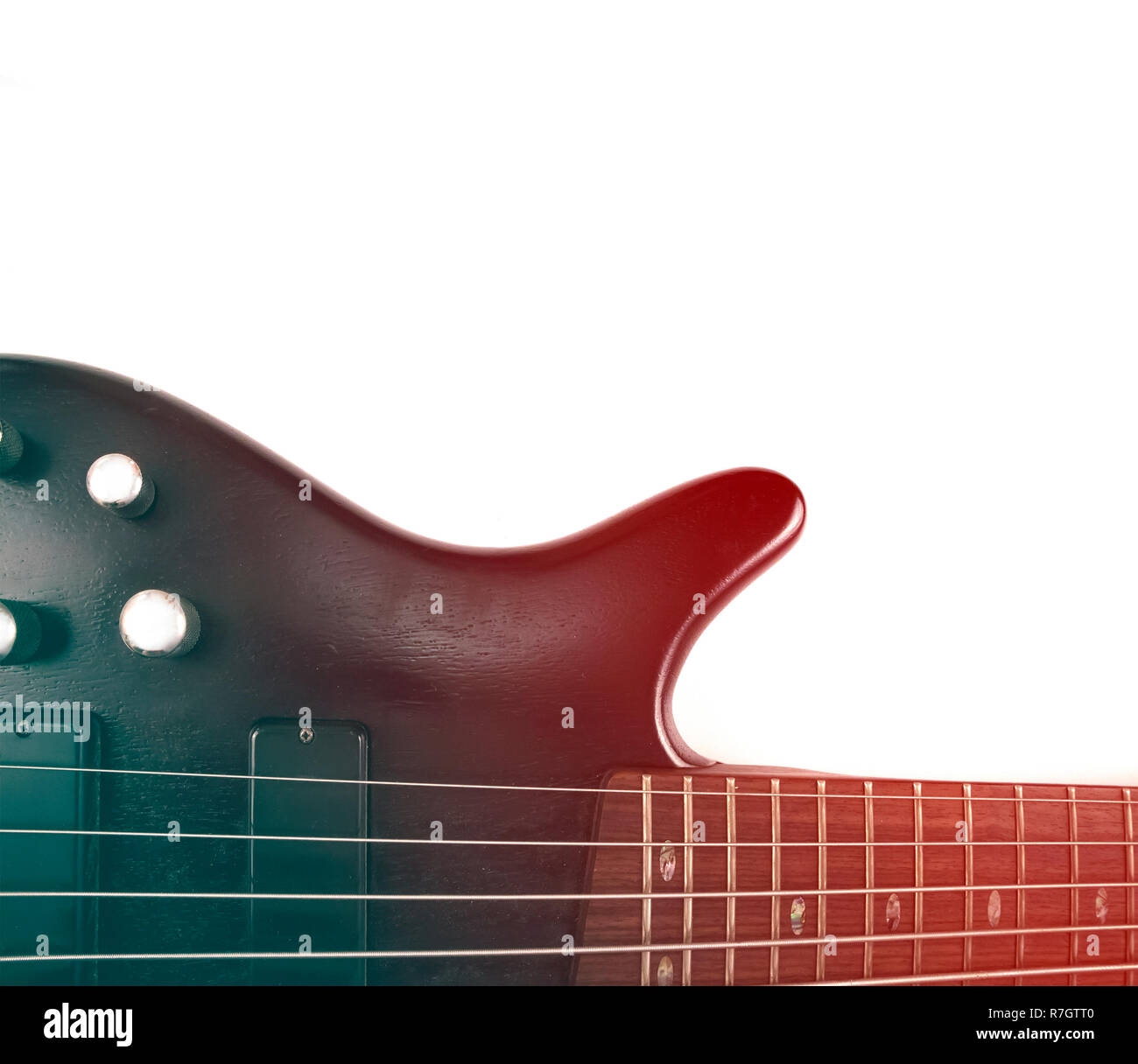 Rosewood bass guitar deck and neck with frets and strings with gradient effect isolated on white Stock Photo