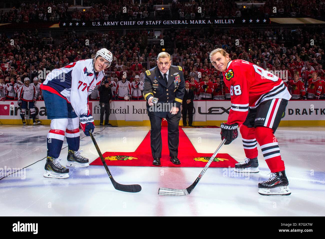 968d116de5f U.S. Army Chief of Staff Gen. Mark Milley prepares to drop the puck to start