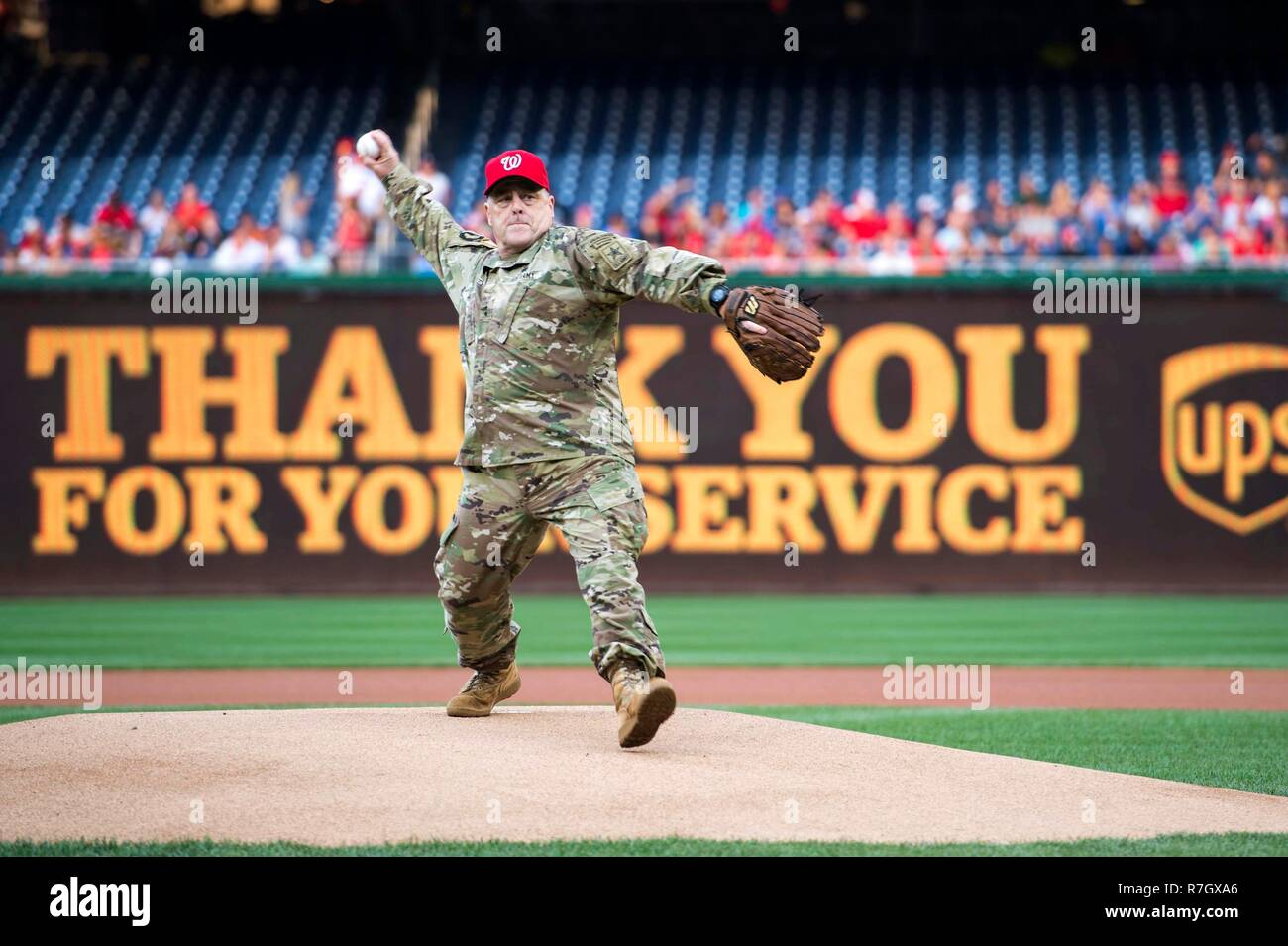 U.S. Army Chief of Staff Gen. Mark Milley throws out the first pitch for the Washington Nationals baseball game during Army Day at Nationals Park June 28, 2016 in Washington, DC. Milley was chosen by President Donald Trump on December 8, 2018 to be the next Chairman of the Joint Chiefs. Stock Photo