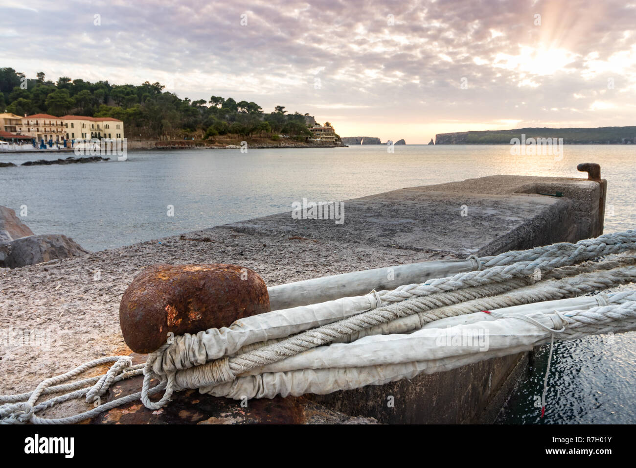A big mooring line of a cruise ship on a bolland the the port of Pylos, Greece. - Stock Image