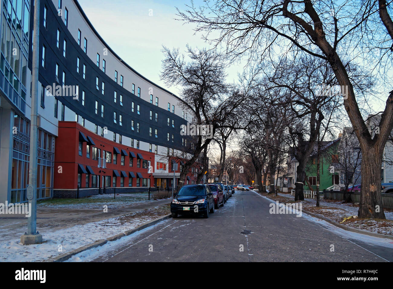 Winnipeg, Manitoba, Canada - 2014 11 16: Langside street view with a student residence in the left. Built on UWinnipeg's western Furby-Langside Campus - Stock Image