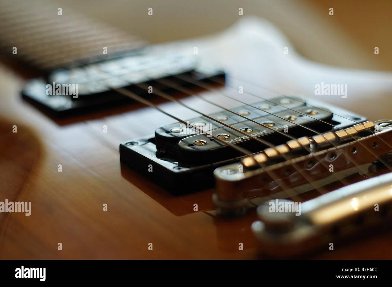 Streams and Bridges. Closeup shot of Washburn Idol WI-64 electric guitar with Tune-o-matic bridge. - Stock Image