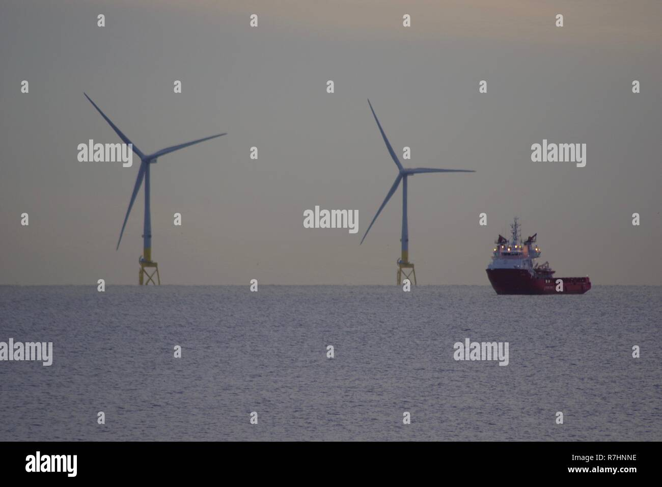 European Offshore Wind Deployment Centre. Renewable Energy Wind Farm, Offshore Aberdeen.  Pair of Wind Turbines and Maintenance Ship. Scotland, UK. - Stock Image