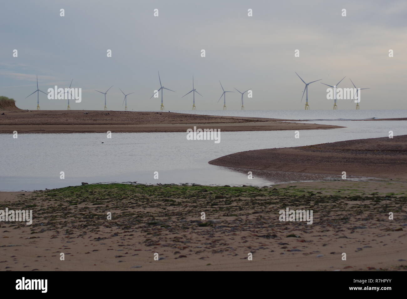 European Offshore Wind Deployment Centre. Renewable Energy Wind Farm, Offshore Aberdeen.Beyond Donmouth Nature Reserve on a Grey Day. Scotland, UK. - Stock Image