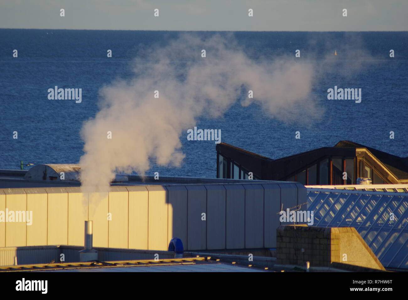 Steam Chimney on the Roof of Aberdeen Beach Leisure Centre on an Autumn Evening. Scotland, UK. - Stock Image