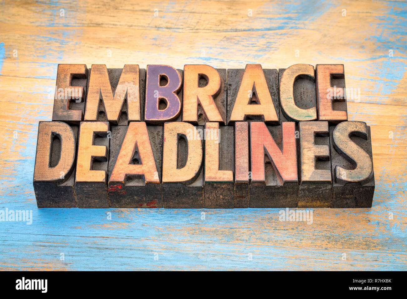 embrace deadlines - word abstract in vintage letterpress wood type blocks - Stock Image