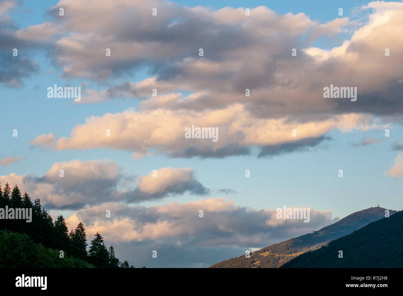Cumulus Cloud formations with blue sky background. Photographed in Stubai, Tyrol, Austria in September - Stock Image