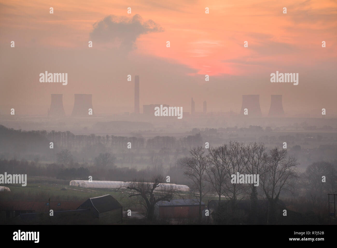 An impressionistic view of Didcot Power Station at sunset from Wittenham Clumps, Oxfordshire, before the South cooling towers were demolished - Stock Image