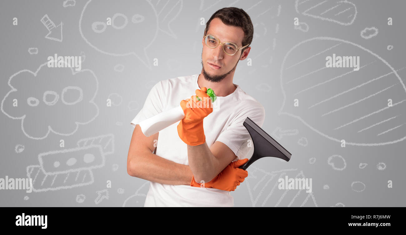 Male housekeeper with and without head with grey doodled wallpaper  Stock Photo