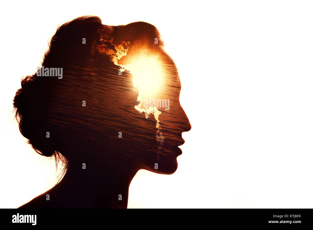 Portrait of smart woman. The sun and clouds. - Stock Image