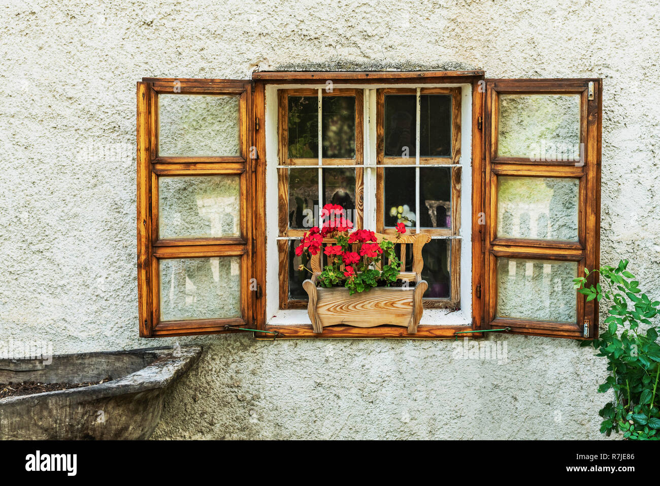 Wooden window with flower box and red geraniums on a house in Tihany, Veszprem county, Central Transdanubia, Hungary, Europe - Stock Image