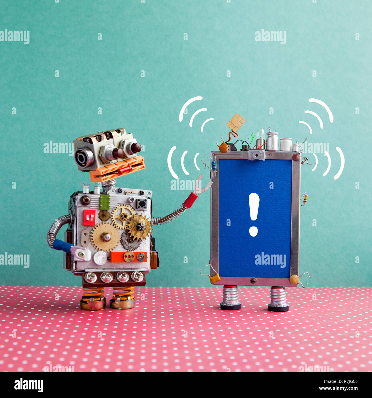 Robot looks at a smartphone with beep sound and exclamation mark on blue screen. Attention and help service concept. Blue red background - Stock Image