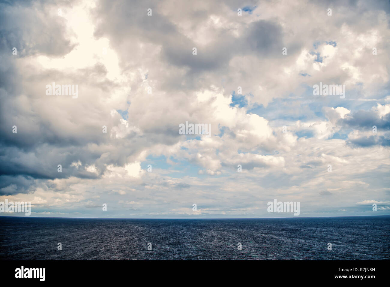 seascape with cloudy sky as natural background - Stock Image
