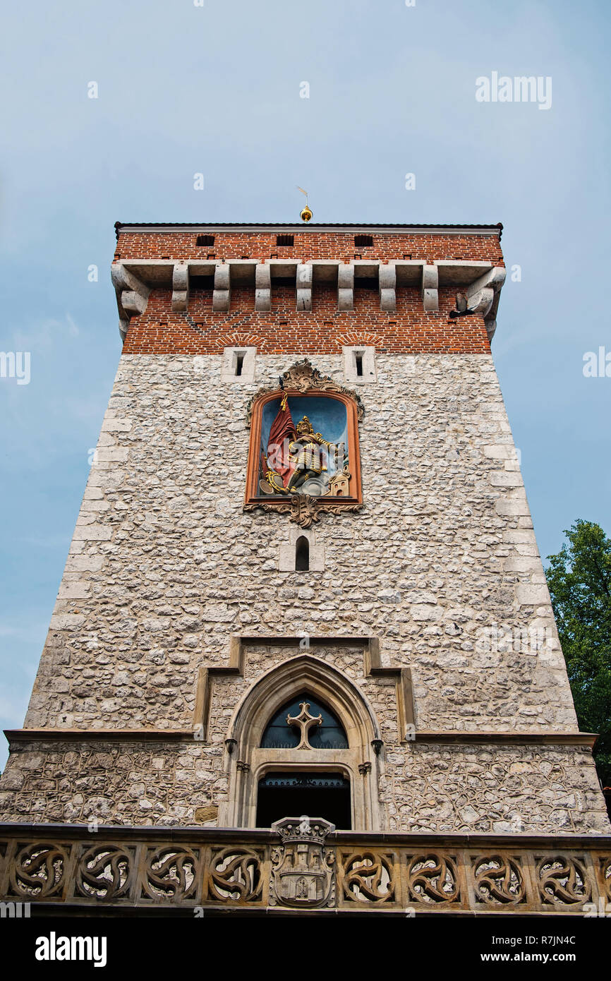 Stone tower on blue sky background in Krakow, Poland. Landmark and sightseeing. Fortification, protection and safety concept - Stock Image