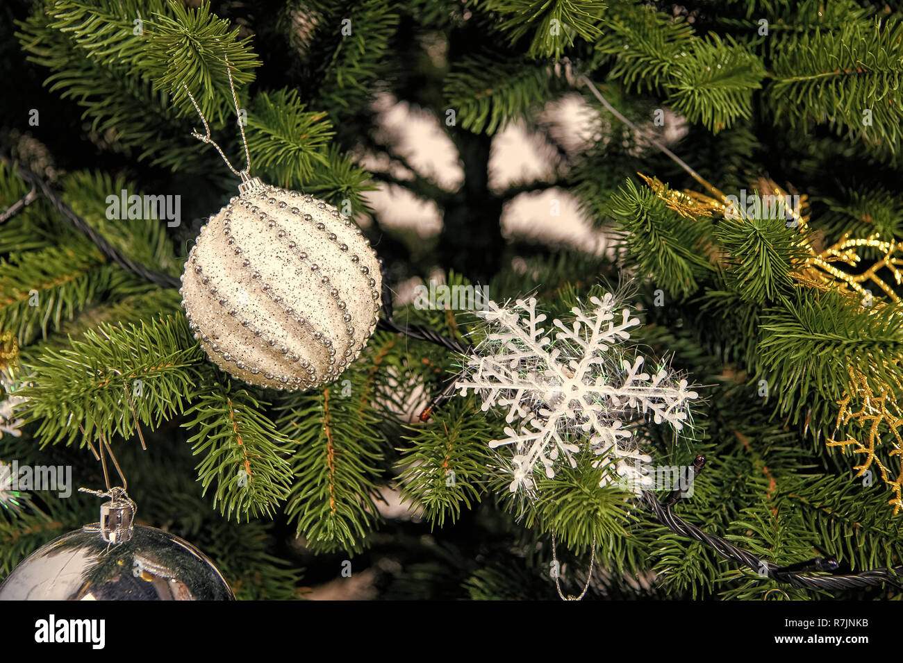 Snowflake And Balls On Green Branches Christmas Tree With Fir